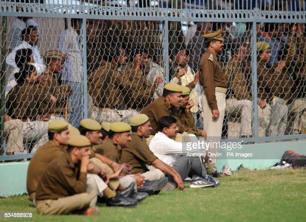 Local police watch as England take part in a practice session at the Green Park Stadium in Kanpur India