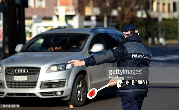 A local policeman in Milan at a checkpoint during the third day of a traffic ban on December 30 2015 in Milan Italy The city of Milan has implemented...
