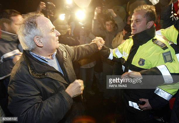 A local policeman stops an unidentified man who was shouting at the mayor of the northern Spanish Basque village of Getxo moderate nationalist Inaki...