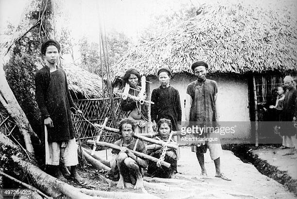 Local prisoners wearing cangues in Indochina circa 1900