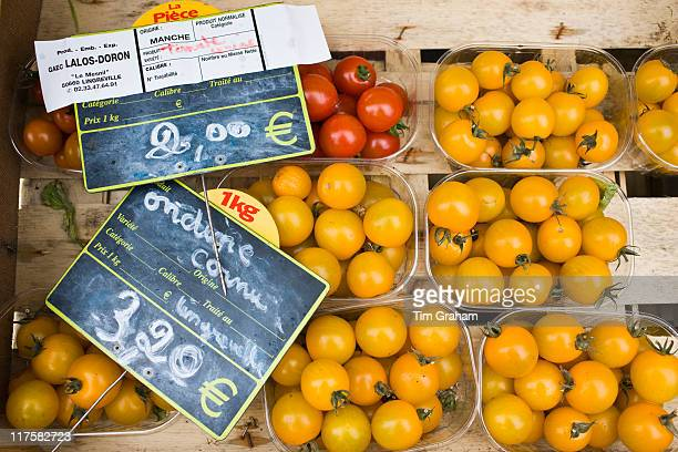 Local produce red tomatoes and yellow tomatoes at farmers market in Normandy France