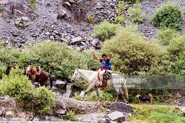 Local Quechua man riding horse on the trail between Iruya and San Isidro The village of San Isidro can only be reached by foot or by horse . When the...