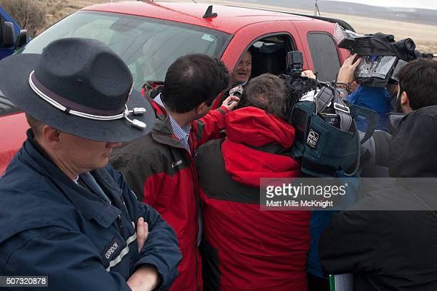Local ranchers speak with media after passing a law enforcement checkpoint at the Malheur National Wildlife Refuge January 28 2016 near Burns Oregon...