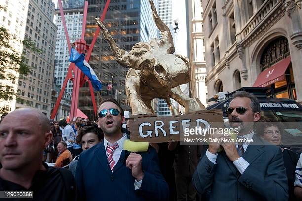 Local religious leaders march a golden calf around the Occupy Wall Street protest encampment in Zuccotti Park.