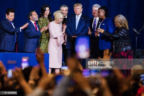 """Local religious leaders pray alongside President Donald Trump at the King Jesus International Ministry during a """"Evangelicals for Trump"""" rally in..."""