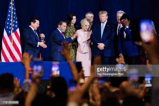 """Local religious leaders pray over President Donald Trump at the King Jesus International Ministry during a """"Evangelicals for Trump"""" rally in Miami,..."""
