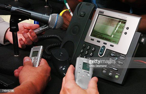 Local reporters hold their recorders up to the phone as Mike Conley Jr holds a telephone conference call after being selected by the Memphis...