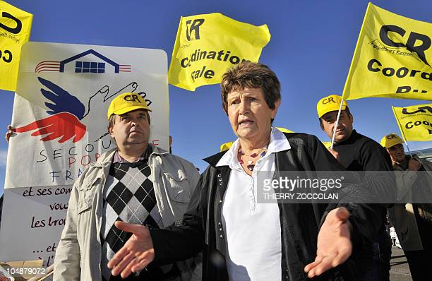 Local representative of French NGO Secours Populaire, Nicole Rouvet arrives to be offered meat by members of the Coordination rurale during a...