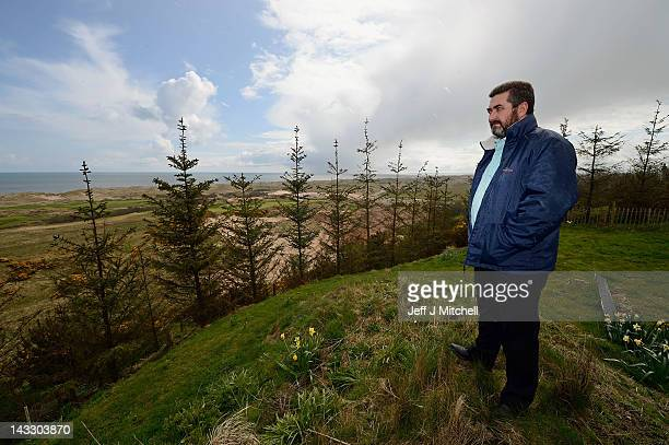 Local resident David Milne views Donald Trump's golf course currently under construction on the Menie estate on April 23 2012 in Aberdeen Scotland Mr...