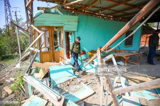 Local resident is seen inside a house damaged by recent shelling during the military conflict over the breakaway region of Nagorno-Karabakh on...