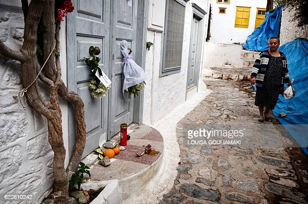 Local resident looks at flowers set up outside the summer house of late Canadian singer-songwriter and poet Leonard Cohen on the Greek island of...