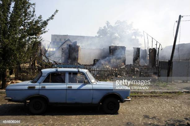 Local resident looks at the rubble of a burnt house following shelling on September 4, 2014 in Debaltseve. Ukraine was poised today to strike a...