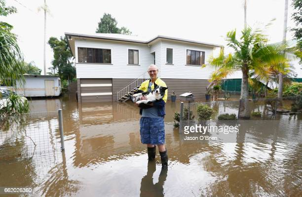 Local resident Michael with his dog ' Buddy' outside there house on April 1 2017 in Lismore Australia Heavy rain has caused flash flooding in south...
