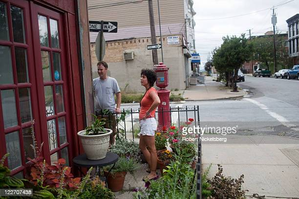 A local resident of Red Hook Shannon Violante checks for water damage on her apartment August 28 2011 in the Brooklyn borough of New York City While...