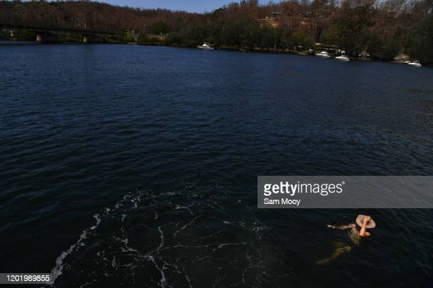 Local resident Paul Lanfear cools off in the fire affected Clyde River near Batemans Bay on January 26, 2020 in Nellingen, Australia. Australia Day,...
