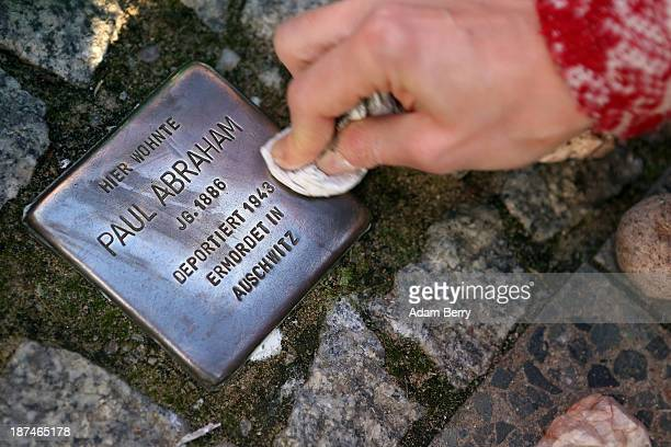 Local resident polishes a 'Stolperstein', or Stumbling Block, one of thousands of small cobblestone-sized plaques by artist Gunter Demnig dedicated...