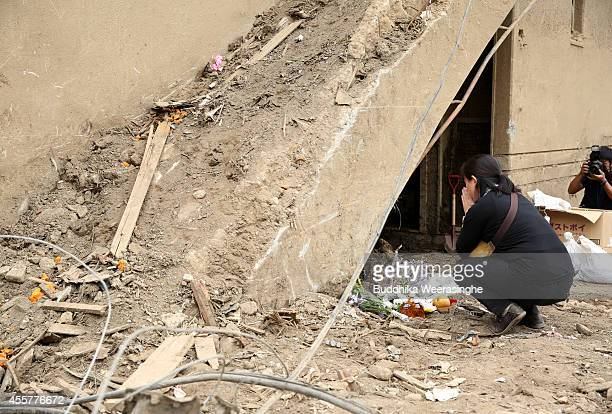 A local resident prays for the victims of the massive landslide at Asamiminami one month after the landslides on September 20 2014 in Hiroshima Japan...
