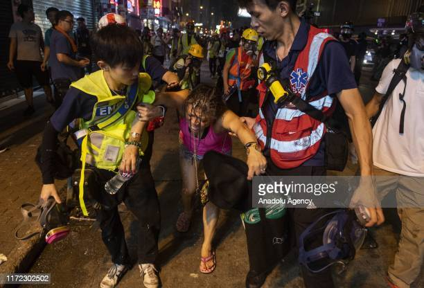 A local resident receives medical aid after police has fired tear gas on September 29 2019 Riot police confronted and fired tear gas and used water...
