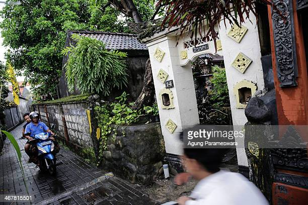 Local resident ride pass a house where Australian drug trafficker Schapelle Corby's sister and brother in law Mercedes Corby and Wayan Widyartha live...