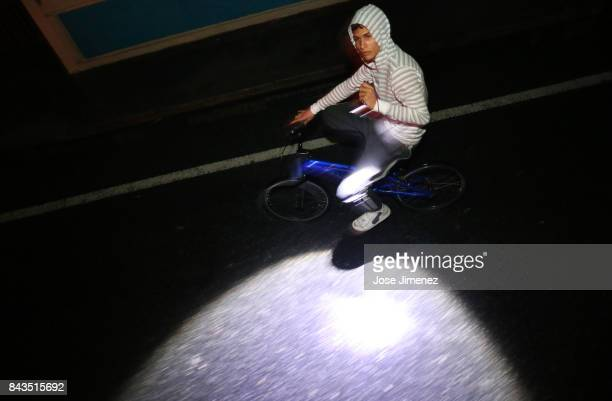 A local resident rides his bike after the passing of Hurricane Irma on September 6 2017 in Fajardo Puerto Rico The category 5 storm is expected to...