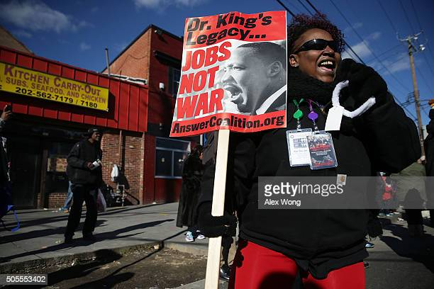 Local resident Robin Fields participates in the annual Martin Luther King Holiday Peace Walk and Parade January 18 2016 in Washington DC The nation...