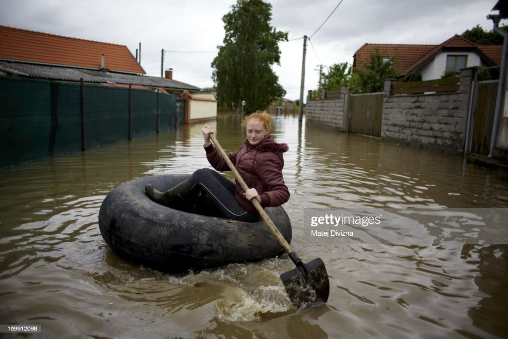 A local resident sails on the tractor pneu through flooded Elbe river near Melnik on June 4, 2013 in Zalezlice, Czech Republic. Seven persons have been killed and several are missing across the country as rivers continue to rise throughout western and mainly nothern Bohemia.