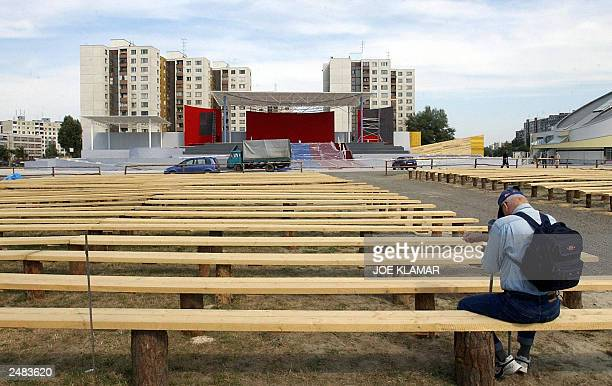 A local resident sits and prays at the Holy Mass construction site in Slovakia's largest communist built housing estate of Petrzalka in Bratislava 08...