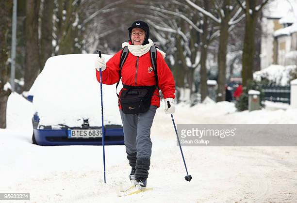 A local resident skis along snowcovered streets in Zehlendorf district on January 11 2010 in Berlin Germany A blizzard has swept across Germany and...