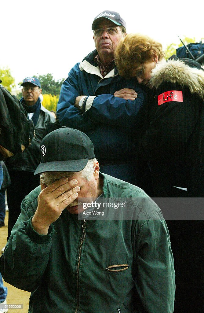 Local resident Stan Stubblefield covers up his eyes during the 'America for Jesus' rally October 22, 2004 at the National Mall in Washington, DC. Although the U.S. Constitution prohibits an official state religion, references to God appear on American money, the U.S. Congress starts its daily session with a prayer, and the same U.S. Supreme Court that has consistently struck down organized prayer in public schools as unconstitutional opens its public sessions by asking for the blessings of God. The Supreme Court will soon use cases from Kentucky and Texas to consider the constitutionality of the Ten Commandments displays on government property, addressing a church-state issue that has ignited controversy around the country.