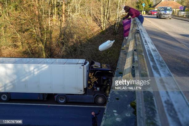 Local resident Suki Abbott distributes provisions to freight lorry drivers as they remain queued up on the M20 motorway, southbound, leading to the...