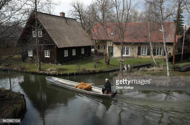 Local resident transports sacks of potatoes on a flat-bottomed canoe called a Kahn on a canal in the Spreewald region on April 5, 2018 in Luebbenau,...