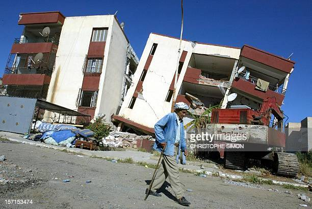 Local resident walks along a builng which was damaged during the 21 May 2003 earthquake 24 May 2003 in Corso east of Algiers The human toll form the...