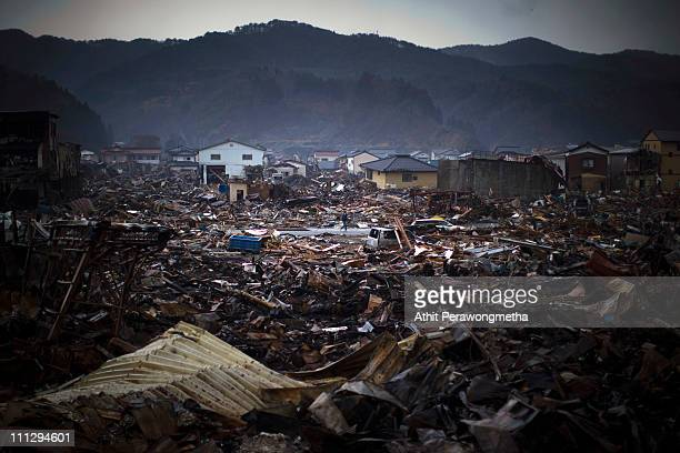 A local resident walks among debris on March 31 2011 in Kesennuma Miyagi Prefecture JapanThe 90 magnitude strong earthquake struck offshore on March...