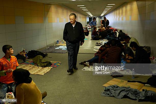 A local resident walks throught a corridor in the Keleti train station where migrants found shelter on September 6 2015 in Budapest Hungary According...