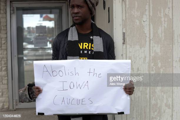 Local resident Wallace Mazon holds a sign outside the Iowa Democratic Party headquarters February 4 2020 in Des Moines Iowa The announcement of the...