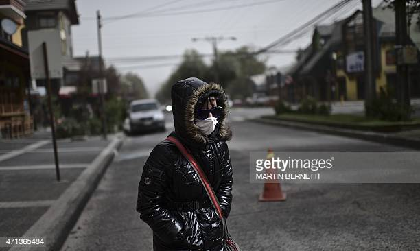 Local resident wears a mask to protect herself from the ashes spewed by the 400-kilometre distant Calbuco volcano in Pucon, southern Chile, on April...