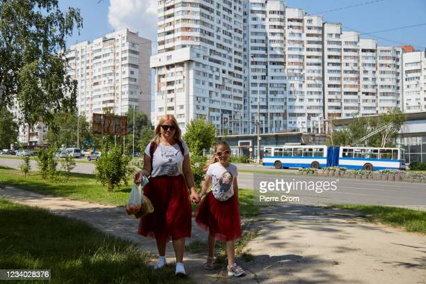Local residents, a mother and daughter, walk to the Zoo of Chisinau on July 14, 2021 in Chisinau, Moldova. The pro-Western PAS party won the...