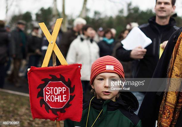 Local residents and activists protesting against the expansion of a nearby coal mine march from the village of Grabko toward the neighboring village...