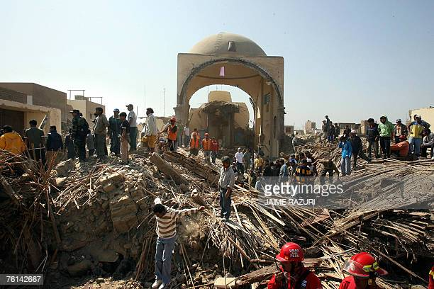 Local residents and rescuers search amid the rubble of a church destroyed by the earthquake that hit a large area of Peru in the eve 16 August 2007...