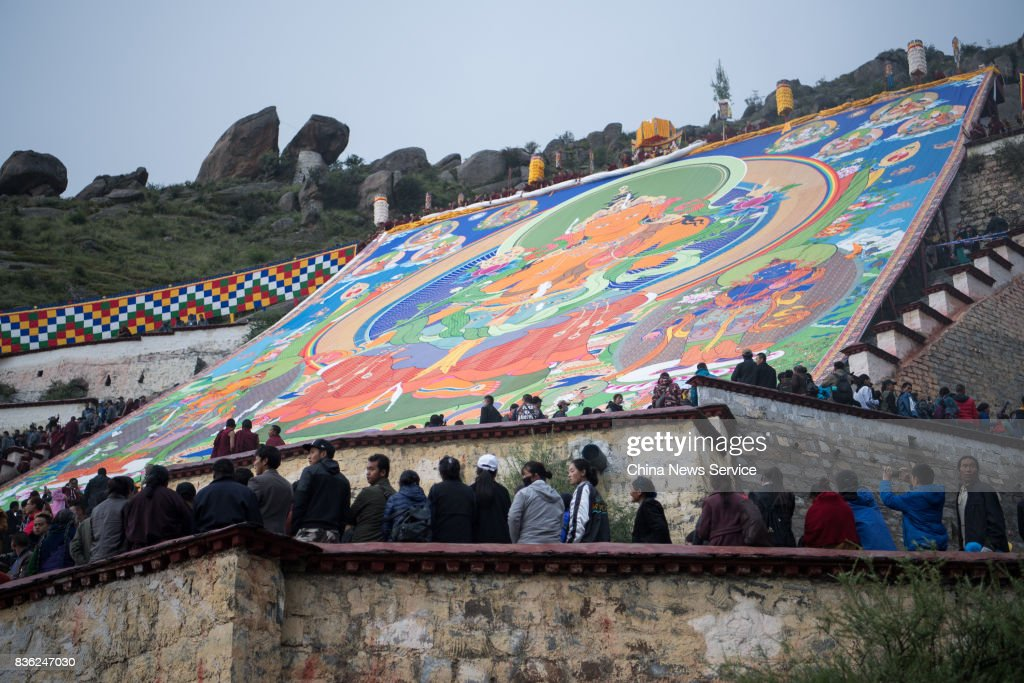 Local residents and tourists worship a large thangka during the Sho Dun Festival at Drepung Monastery on August 21, 2017 in Lhasa, China. The Sho Dun Festival, also known as the Yogurt Festival, will run from August 21 to 27.