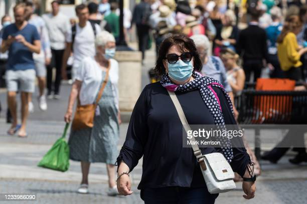 Local residents and visitors shop in the town centre, some choosing to wear face coverings outside, on 14th July 2021 in Windsor, United Kingdom. The...