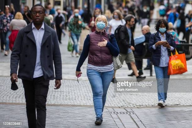 Local residents and visitors, some wearing face coverings, shop in Peascod Street on 27th August 2020 in Windsor, United Kingdom. Tessa Lindfield,...