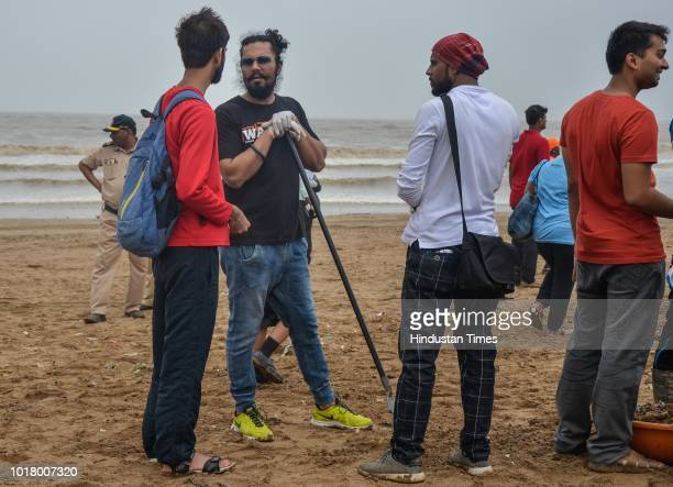 Local residents and volunteers participate during a beach cleanup campaign at Versova on August 15 2018 in Mumbai India