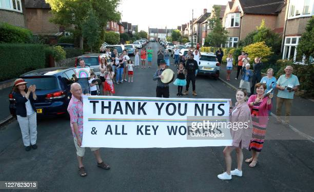 Local residents applaud the NHS and other Key Workers, observing the social distancing rules, on May 28, 2020 in Northampton, United Kingdom. For 10...