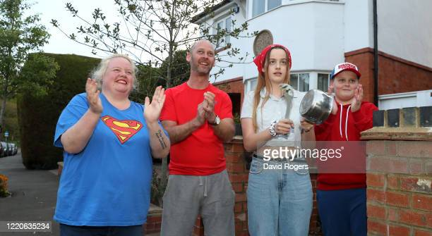 Local residents applaud the NHS and other key workers on April 23 2020 in Northampton United Kingdom Following the success of the Clap for Our Carers...