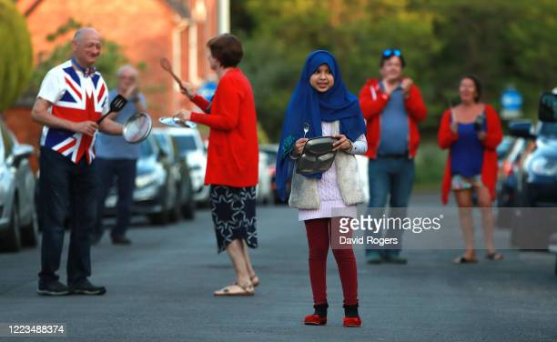 """Local residents applaud the NHS and other key workers on May 07, 2020 in Northampton, United Kingdom. Following the success of the """"Clap for Our..."""