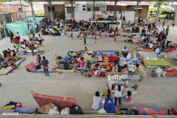 Local residents are housed in a shelter for victims of the mudslides caused by heavy rains in Mocoa Putumayo department southern Colombia on April 5...