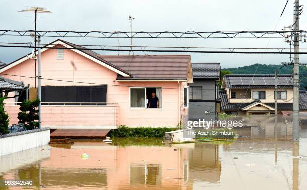Local residents are seen at submerged area as heavy rain continues on July 7, 2018 in Kurashiki, Okayama, Japan. 50 people are dead and at least 67...