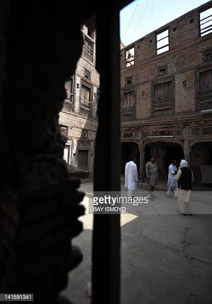 Local residents are seen in the compound of a 200year old house undergoing ownership disputes between heirs residents and the local government in the...