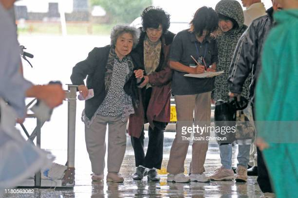 Local residents arrive at an evacuation centre as Typhoon Hagibis approaches on October 12, 2019 in Kyonan, Chiba, Japan. The Japan Meteorological...